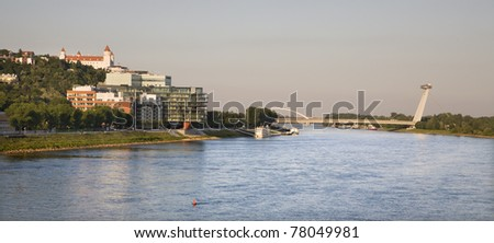 castle and modern buildings in bratislava - Danube riverside - stock photo