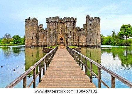 Castle and surrounding pond - stock photo