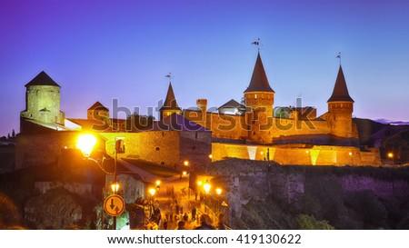 Castle at a moonlight night. Illuminationed castle. Kamenets-podolsky. Ukraine - stock photo