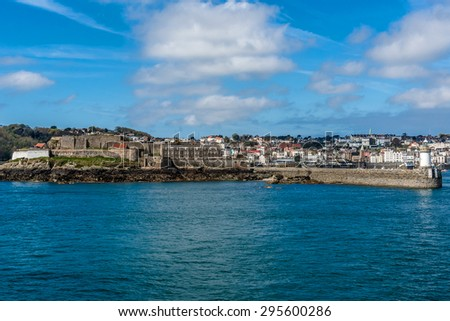 Castle Cornet has guarded Saint Peter Port for 800 years. Saint Peter Port - capital of Guernsey - British Crown dependency in English Channel off the coast of Normandy. View from English Channel. - stock photo