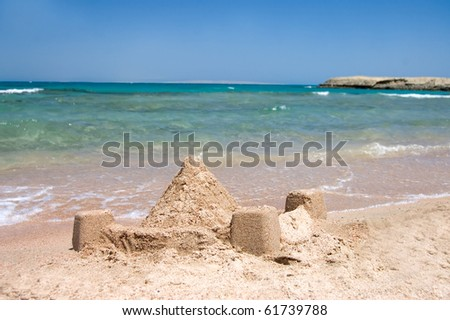 Castle from sand at the sea - stock photo