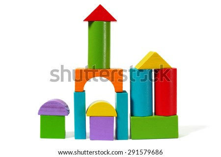 Castle from wooden blocks on white background - stock photo