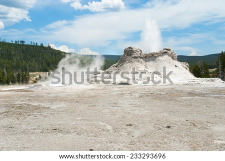 Castle Geyser erupting in the Upper Geyser Basin of Yellowstone National Park - stock photo