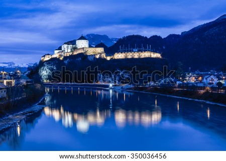Castle Kufstein reflecting in Inn river in Austria - architecture and travel background - stock photo