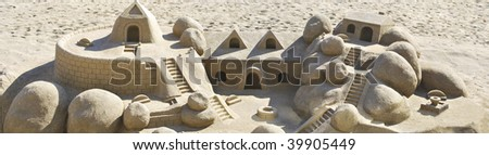 Castle made of sand in the beach. Leisure concept - stock photo
