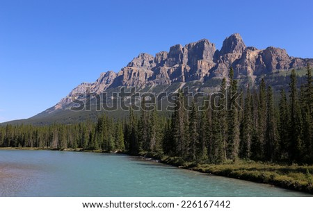 Castle Mountain and the Bow River.  Located in Banff National Park in Alberta, Canada.  - stock photo