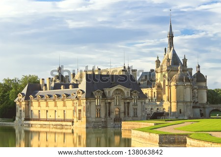 Castle of Chantilly at sunset. France - stock photo
