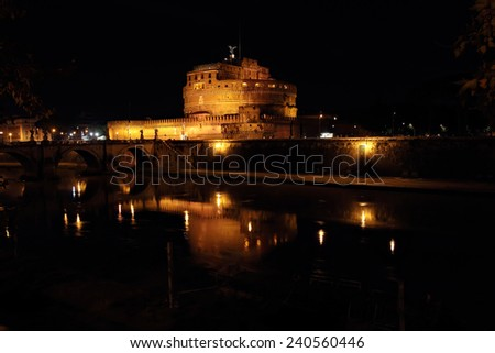 Castle of Holy Angel and Holy Angel Bridge over the Tiber River in Rome at Night, Italy - stock photo