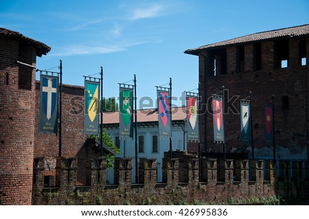 castle of legnano, a small town just outside milan, decorated for grabs with the flags of the eight districts, italy - stock photo
