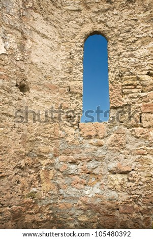 castle stone wall with a window - stock photo