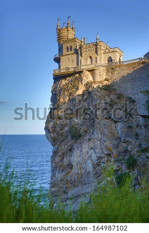 Castle Swallows Nest on the cliff near the sea - stock photo