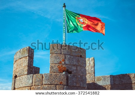 Castle turret with a flag of Portugal. - stock photo