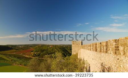 Castle wall, overlooking Portuguese landscape - stock photo