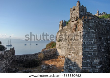 Castle walls and boats in marina Bodrum, Turkey - stock photo
