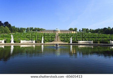Castle with blue lake and green park in Potsdam, German - stock photo