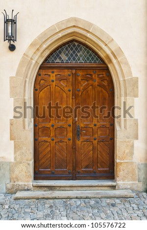 castle wooden door with a lantern - stock photo