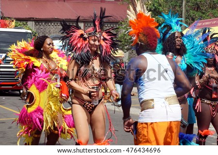 CASTRIES, SAINT LUCIA - CIRCA JULY 2015: Elaborately costumed dancers in the carnival parade in the capital
