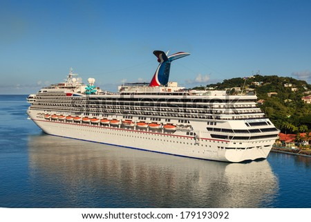 CASTRIES, ST LUCIA - NOVEMBER 7: Cruise ship Carnival Valor docked in Castries on November 7, 2013. The Valor operated by Carnival Cruises whose maiden voyage was in 2004 was built at a cost of $500m. - stock photo
