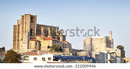CASTRO URDIALES, SPAIN - 27 SEPTEMBER, 2014 : Church of St. Mary of the Assumption and lighthouse in Castro Urdiales, Spain on 27 September 2014.