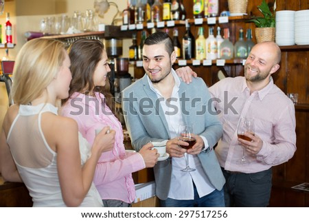 Casual acquaintance of attractive smiling young adults at bar. Selective focus