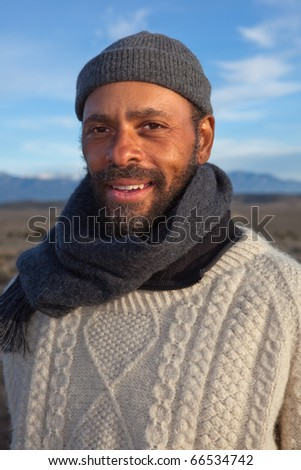 Casual African American man enjoying an afternoon outdoors - stock photo