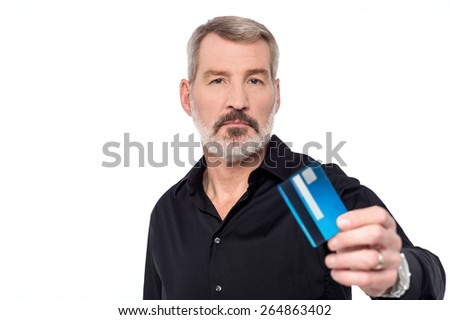 Casual aged man showing his credit card - stock photo