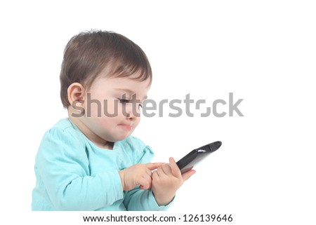 Casual baby touching a mobile phone with a white isolated background - stock photo