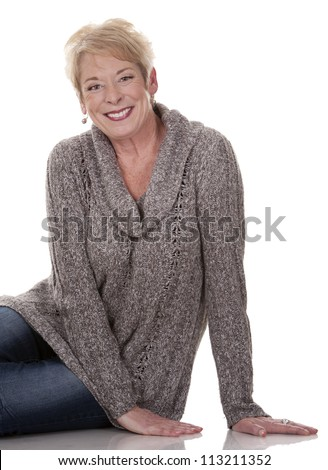 casual blond woman in her fifties on white isolated background - stock photo