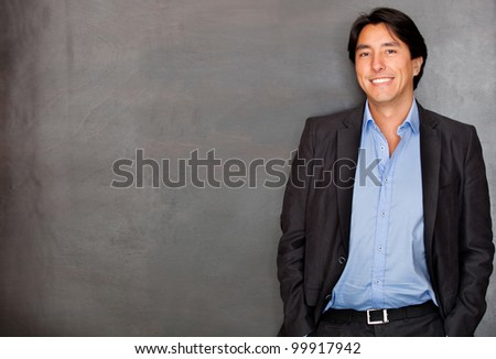Casual business man smiling and looking confident - stock photo