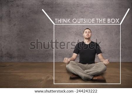 Casual business man thinking outside the box. Meditation - stock photo