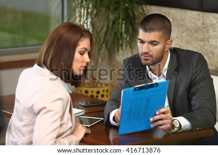 Casual business meeting of man and woman in caffee - stock photo