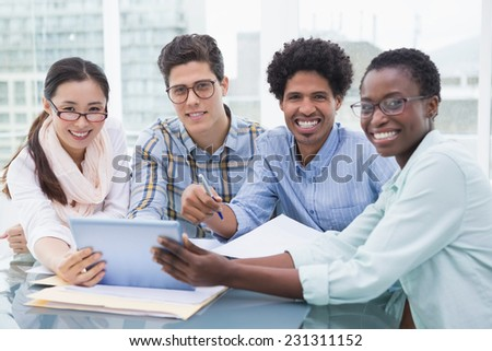 Casual business team having a meeting in creative office - stock photo