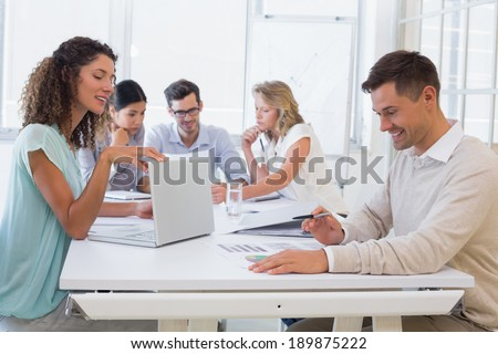 Casual business team having a meeting in the office - stock photo