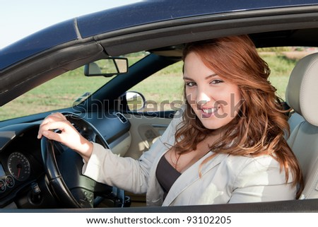 Casual business woman smiling on a car