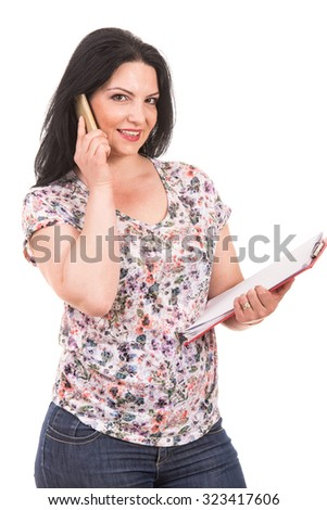 Casual business woman speaking by phone and holding papers isolated on white background