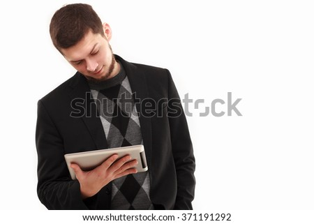 Casual businessman joyfully looking at his tablet screen  isolated on white - stock photo