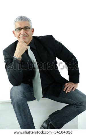 Casual businessman wearig jeans and jacket, thinking leaning on hands. Isolated on white.