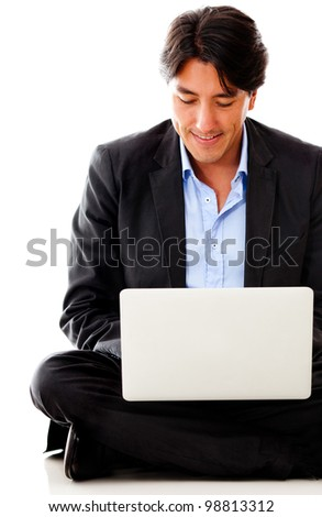 Casual businessman with a laptop computer - isolated over a white background