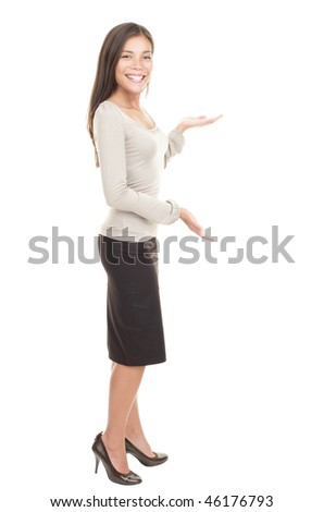 Casual businesswoman with a showing copy space gesture. Gorgeous kind looking young mixed race chinese / caucasian woman. Isolated on white background. - stock photo