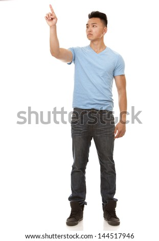 casual chinese man pointing on the white background
