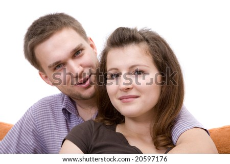 casual couple sitting on sofa