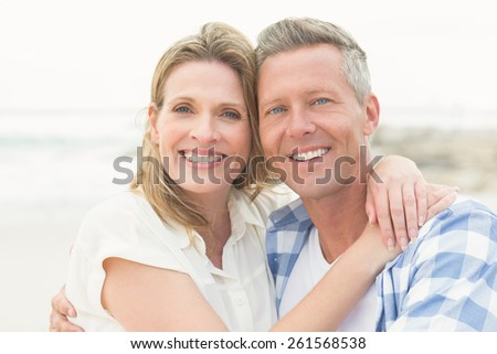 Casual Couple Smiling At Camera The Beach