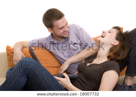 casual couple together on sofa - stock photo