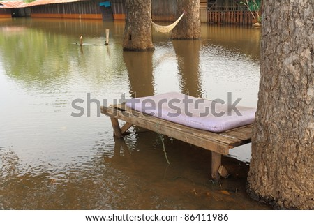 Casual day.Bed under the trees and flooding the area. - stock photo