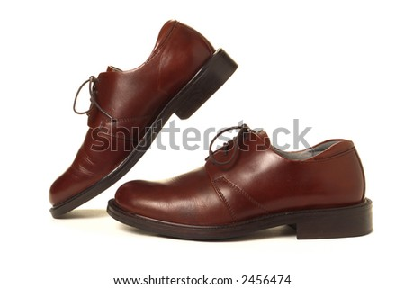 Casual dress men leather shoe in a step over white background - stock photo