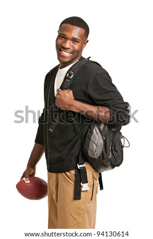 Casual Dressed Happy College Black Student Holding Football Isolated on White Background - stock photo