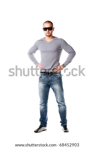 Casual friendly man in jeans and pullover - isolated over a white background. Gangsta man. - stock photo