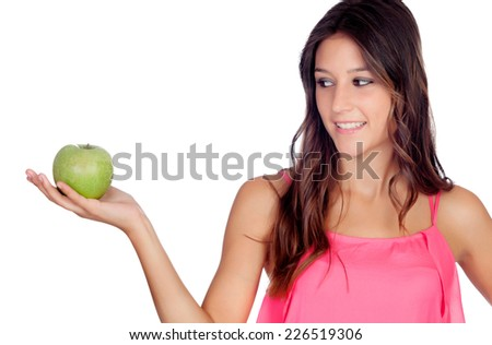 Casual girl in pink with a green apple isolated on a white background - stock photo