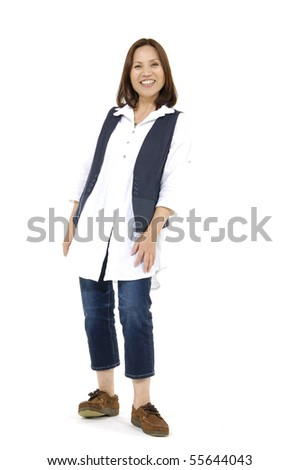 casual girl standing up over a white background - stock photo
