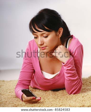 Casual girl with cellphone - stock photo